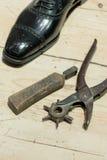 Cobbler's Scene. Shoemakers' tools on Wooden Worktop Bench royalty free stock image