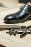 Cobbler's Scene. Shoemakers' tools on Wooden Worktop Bench royalty free stock images