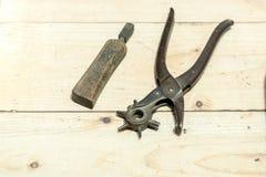 Cobbler's Scene. Shoemakers' tools on Wooden Worktop Bench stock image
