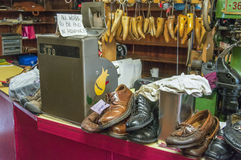 A cobbler's workshop with equipment and shoes to be repaired . Stock Images