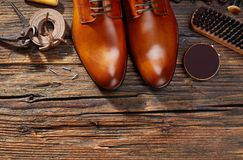 Cobbler`s workshop from above. Men leather shoes on wood royalty free stock photo