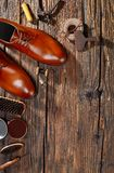 Cobbler`s workshop from above. Men leather shoes on wood royalty free stock photography