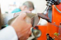 Cobbler shaping heel shoe. Cobbler shaping heel of shoe royalty free stock photos