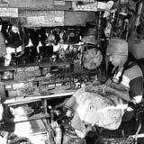 Cobbler. Shoe solers on the street corner stock photo