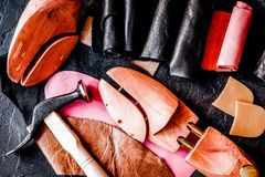 Cobbler tools in workshop dark background top view close up. Cobbler tools in workshop on dark background top view close up royalty free stock images
