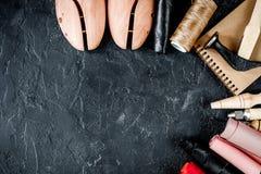 Cobbler tools in workshop dark background top view mock up. Cobbler tools in workshop on dark background top view mock up stock images