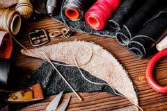 Cobbler tools in workshop on wooden background mock up.  stock image