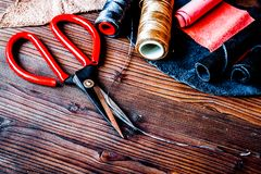 Cobbler tools in workshop on wooden background mock up.  royalty free stock photo