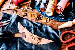 Cobbler tools in workshop on wooden background mock up.  stock photos