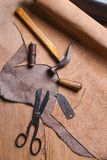 Cobbler tools in workshop on the wooden table . Top view. Cobbler tools in workshop on a wooden table . Top view royalty free stock photos