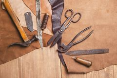 Cobbler tools in workshop on the wooden table . Top view. Cobbler tools in workshop on wooden table . Top view royalty free stock photos