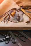 Cobbler tools in workshop on the wooden table . Top view. Cobbler tools in workshop on a wooden table . Top view royalty free stock image