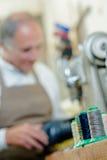 Cobbler in well equipped workshop. Cobbler in his well equipped workshop Royalty Free Stock Images