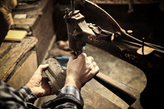 Cobbler at work Royalty Free Stock Images