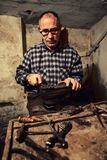 Cobbler at work Stock Photo
