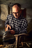 Cobbler at work. With old tools royalty free stock images