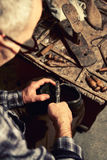 Cobbler at work. With old tools royalty free stock photos