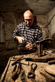 Cobbler at work. With old tools royalty free stock photo