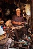 Cobbler at work. Marrakesh. Morocco stock photo