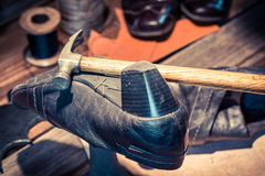 Cobbler workplace with brush and shoes Royalty Free Stock Photos