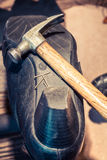 Cobbler workplace with shoes, laces and tools Stock Photo