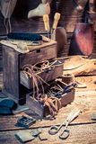 Cobbler workshop with brush and shoes Stock Photo