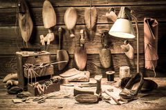 Cobbler workshop with tools, shoes and laces stock image