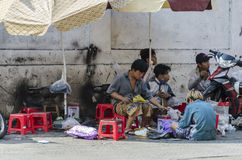 Cobblers working on street Vietnam Royalty Free Stock Photos