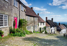 Cobbles at Gold Hill. Picturesque English cottages on a cobbled street at Gold Hill in Shaftestbury in Dorset Stock Images