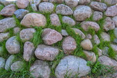 The cobbles in the grass. Backdrop Stock Photo