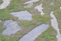 The cobbles in the grass. Backdrop Royalty Free Stock Photos