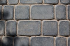 Cobbles. The old gray stone cobbles stock photo