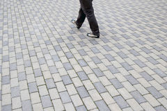 Cobbles square pattern, the women go away Royalty Free Stock Photography