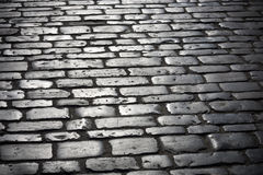 Cobbles Street. Well worn cobbles on an ancient street stock photography