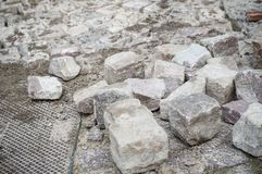 Cobbles for street paving site. Closeup of cobbles for street paving site stock photo
