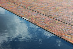Cobbles and surface water in sunshine Stock Images