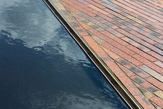 Cobbles and surface water in the sunshine Royalty Free Stock Photography
