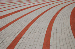 Cobblestone. Detail of traditional paving-stones, gray, red stock photo
