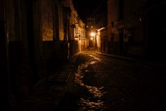 Cobblestone Alley at Night. Nightime scene in a cobblestone alley or street in the classic Spanish colonial mountain mining town of San Miguel de Allende, Mexico Stock Photo