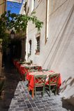 Cobblestone alley restaurant Stock Photo
