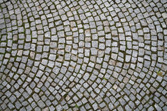 Cobblestone background pattern. Closeup view on a cobblestone road - pattern - background Royalty Free Stock Image