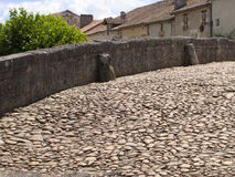 Cobblestone bridge in St Jean de Cole, Dordogne, France Stock Photos