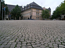 Cobblestone courtyard. Leading to a European building Stock Photo
