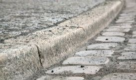 Cobblestone curb. A cobblestone street and curb Stock Images