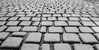 Cobblestone. On footpath in black and white tone, selective focus royalty free stock image