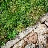 Cobblestone and grass Stock Image