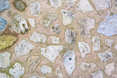 Cobblestone with grass texture Royalty Free Stock Image