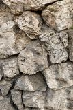 Cobblestone gray beige part of the stone slope powerful wall base design natural surface royalty free stock photography