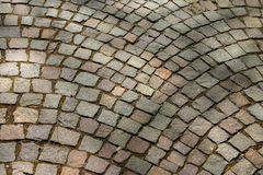 Cobblestone lane. Shades on cobbled pavement stock images