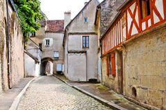 Cobblestone lane in a Burgundy village, France Royalty Free Stock Image
